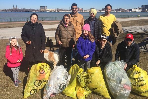 Volunteers collected bags of trash during last year's clean-up along the Detroit River.