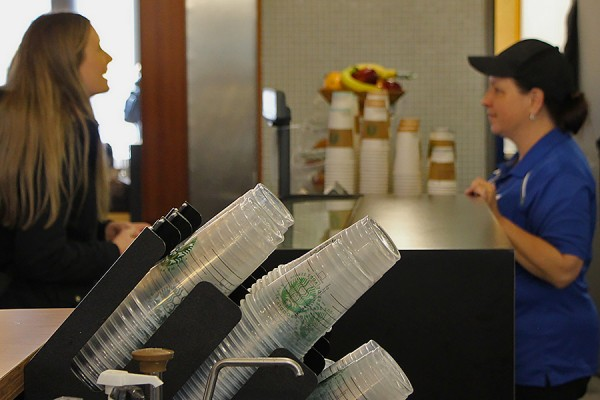 Starbucks staff serve campus customers