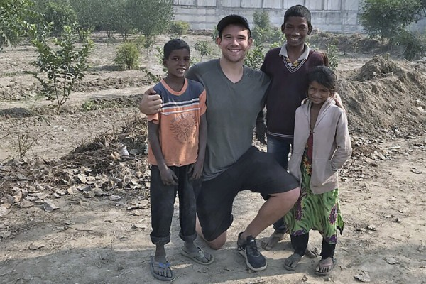 Dylan Verburg was often greeted by youngsters Kishan, Guddu, and Maya