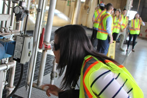 Computer science student Tong Li gets a close look at a gauge in the Hiram Walker and Sons distillery.