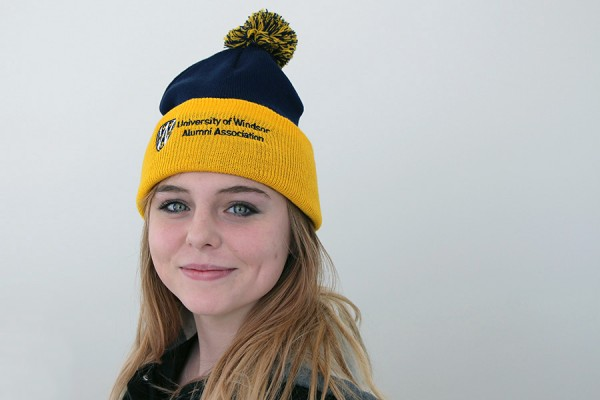 This toque in Lancer colours, modelled by drama student Paige Romberg, will warm up the entrant who won it in a trivia contest.