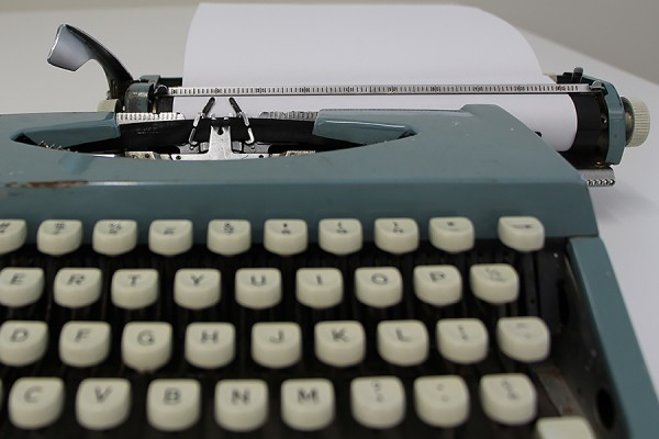 typewriter with blank paper inserted