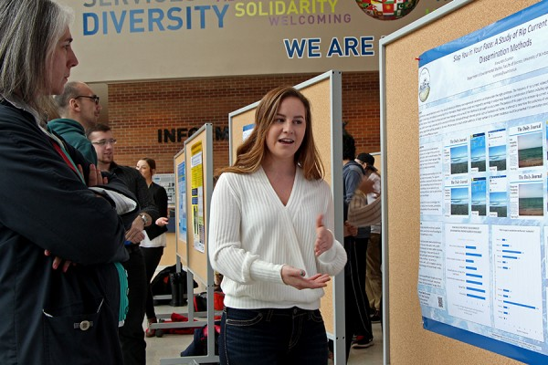 Alexandra Scaman describes her research poster