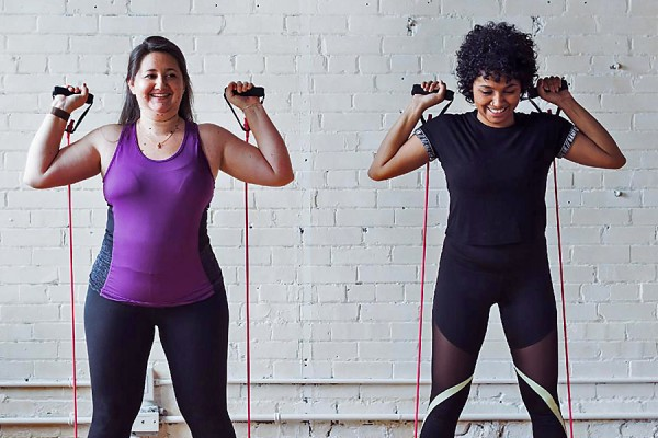 women working out with strong bands