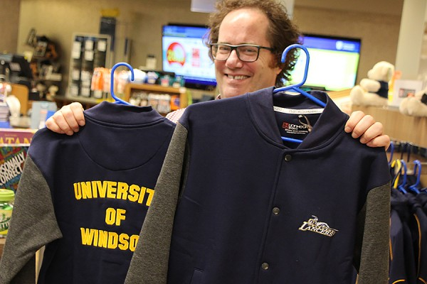 Martin Deck shows off a fleece varsity jacket available in the Campus Bookstore.