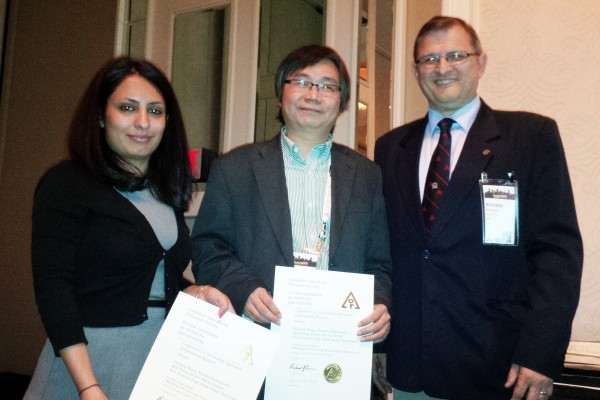 PhD student Nooshin Nekoiemehr (l.) and engineering professor Guoqing Zhang (centre) accepted congratulations from chief judge Dr. Richard Caron (r.) for receiving the first practice prize at the national conference of the Canadian Operational Research So