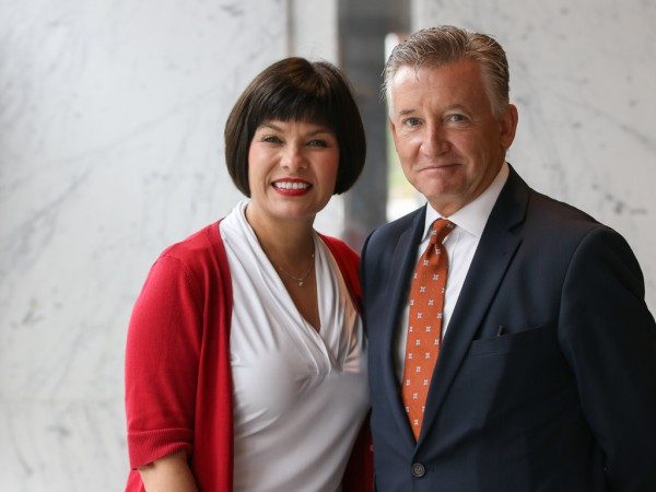 The Honourable Ginette Petitpas Taylor, Canada's Minister of Health, and University of Windsor President Douglas Kneale, pose for a photo before entering a roundtable discussion about the opioid crisis with local first responders, health care providers an
