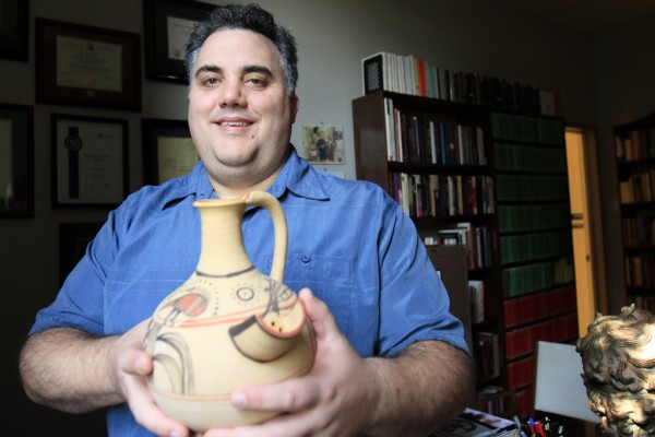 UWindsor history professor Max Nelson holds a reproduction of a Philistine beer jug from around 1200 BC in his office on Sept. 22. Dr. Nelson will participate in a symposium discussing the ancient beverage on Sept. 30.