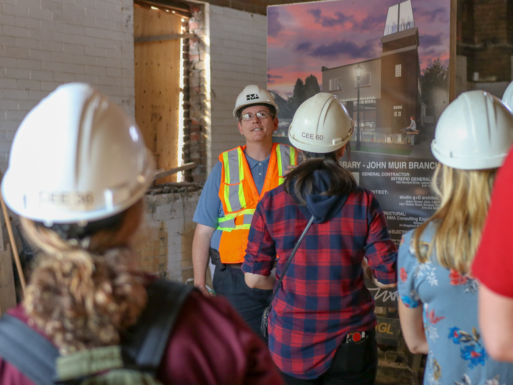 UWindsor civil engineering sessional instructor William Tape leads fourth-year students through the construction site of the Windsor Public Library Sandwich branch on Aug. 3, 2018.