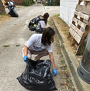 students picking up litter