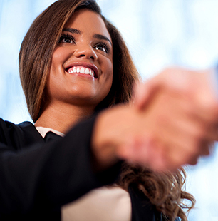 Young woman professional shaking hands
