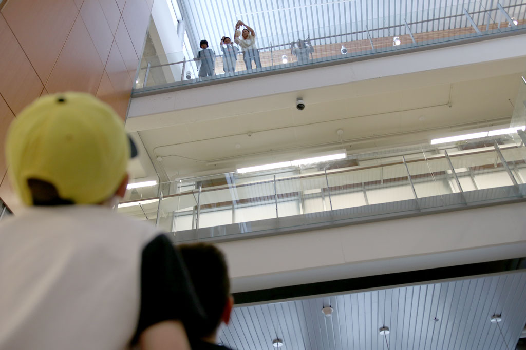 An egg is dropped from the third floor of the Ed Lumley Centre for Engineering Innovation on Wednesday during the Lancer Engineering Camp.
