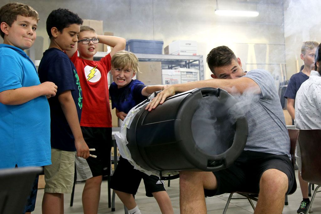 A camper takes aim at a foam cup with an air cannon during the Lancer Engineering camp on Wednesday.