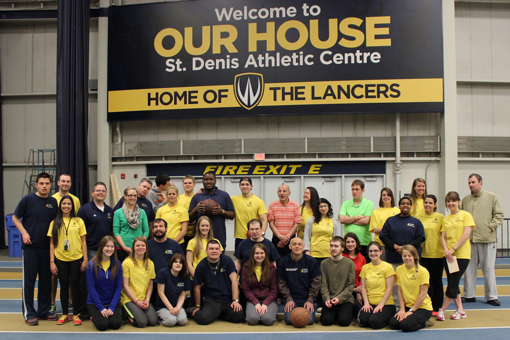 Participants in the Adapted Physical Exercise (APEX) program coordinated by PhD student Kelly Carr pose at the St. Denis Centre in this 2014 handout photo.
